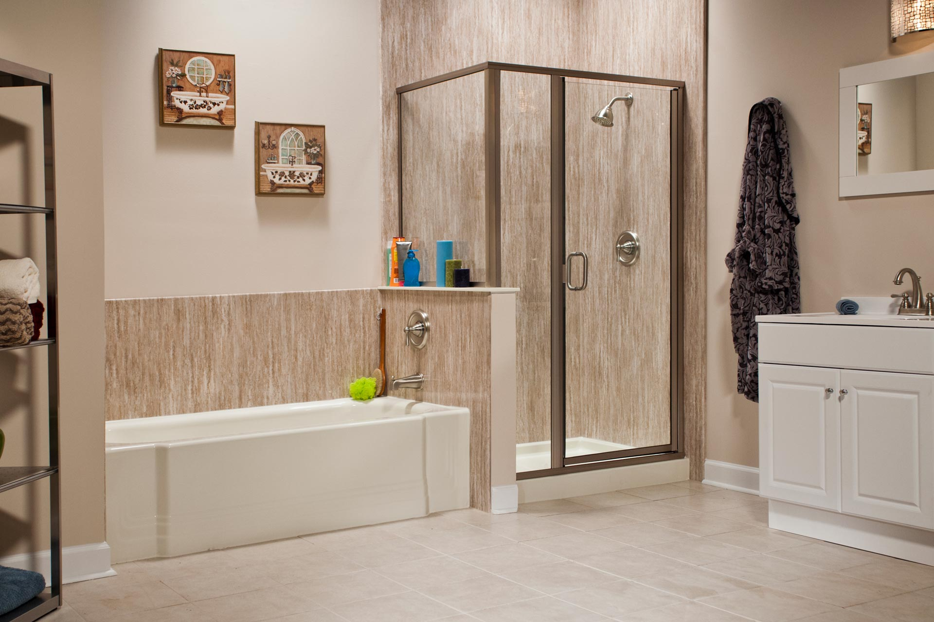 A beautiful, remodeled bathroom with natural stone wall surround, soaking tub, and walk-in shower.