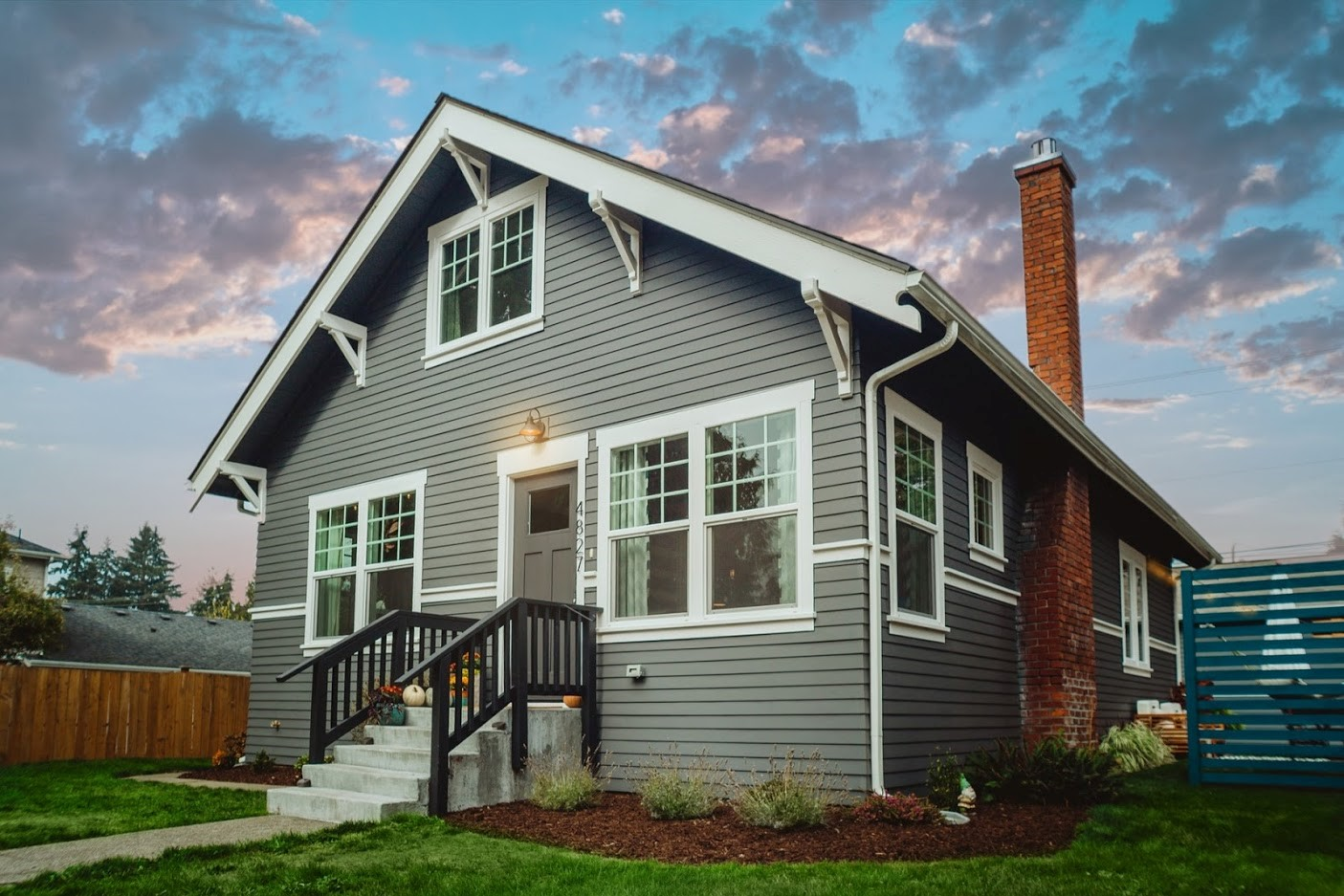 A beautiful suburban home with new siding and windows.